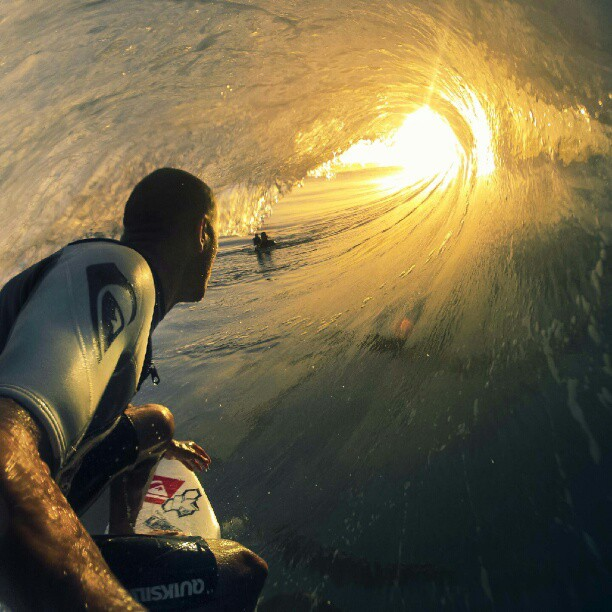 kelly slater surfing watches sunset