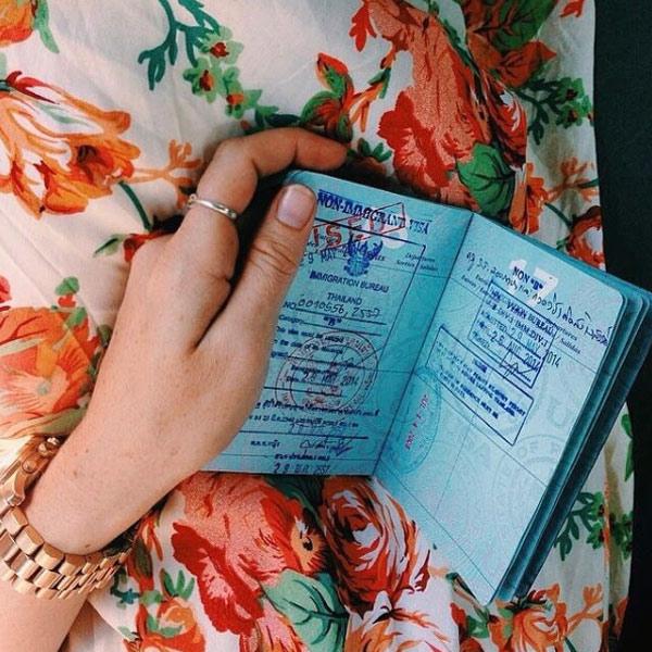 holding passport photo instagram
