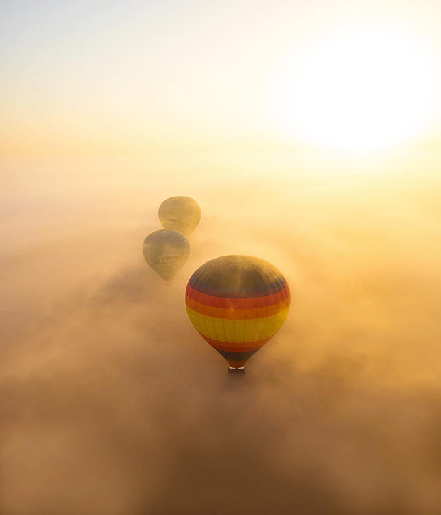 hot air balloon clouds dubai